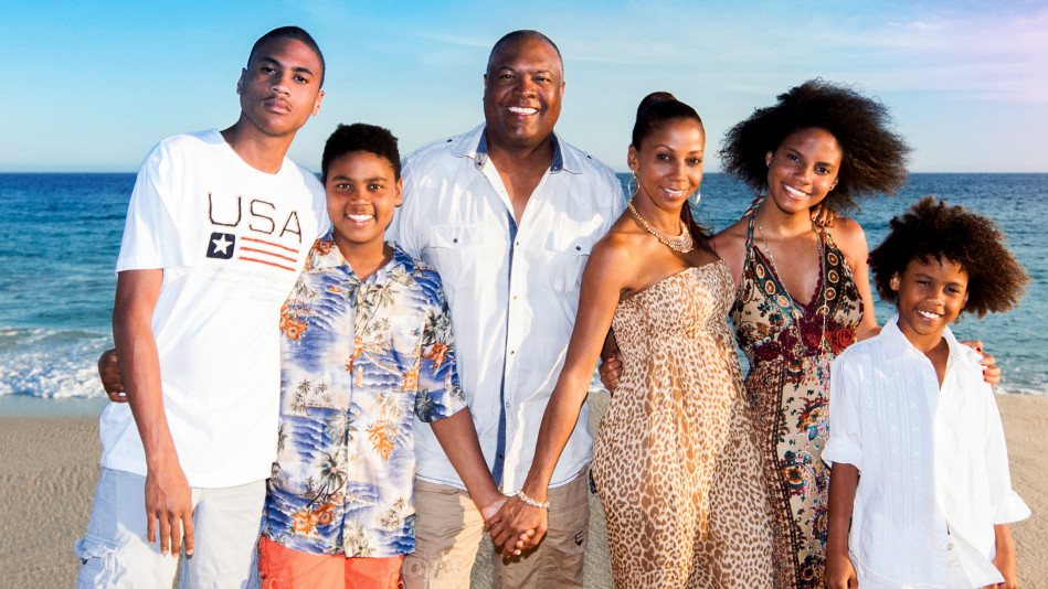 Rodney Peete and Holly Robinson Peete with their children