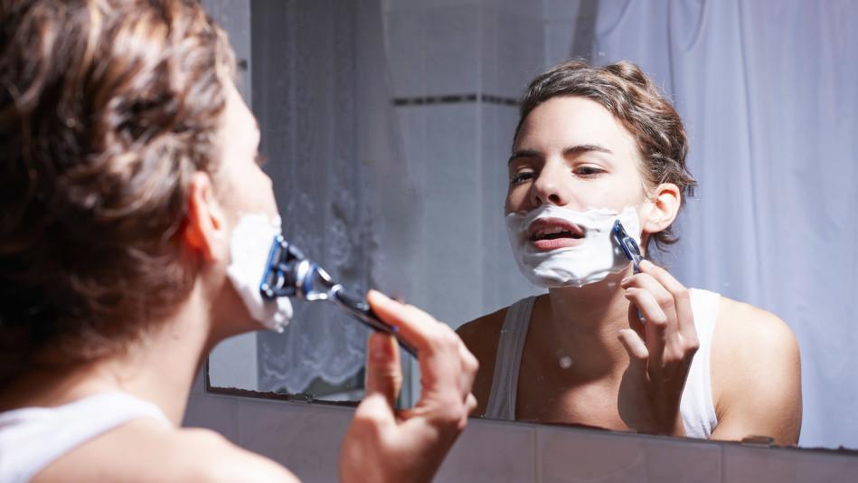 women shaving face