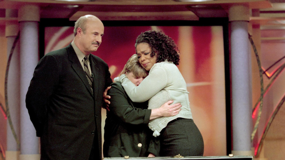 Oprah hugging guest with Dr. Phil on The Oprah Winfrey Show