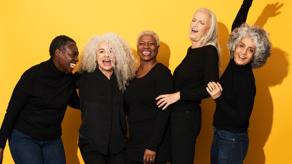Women in their 50s laughing