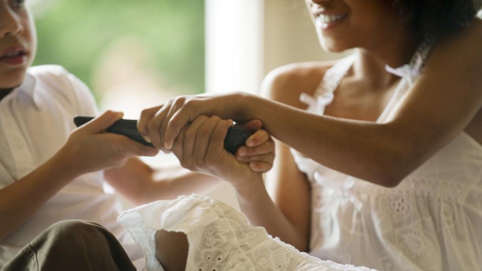 Children fighting over remote control