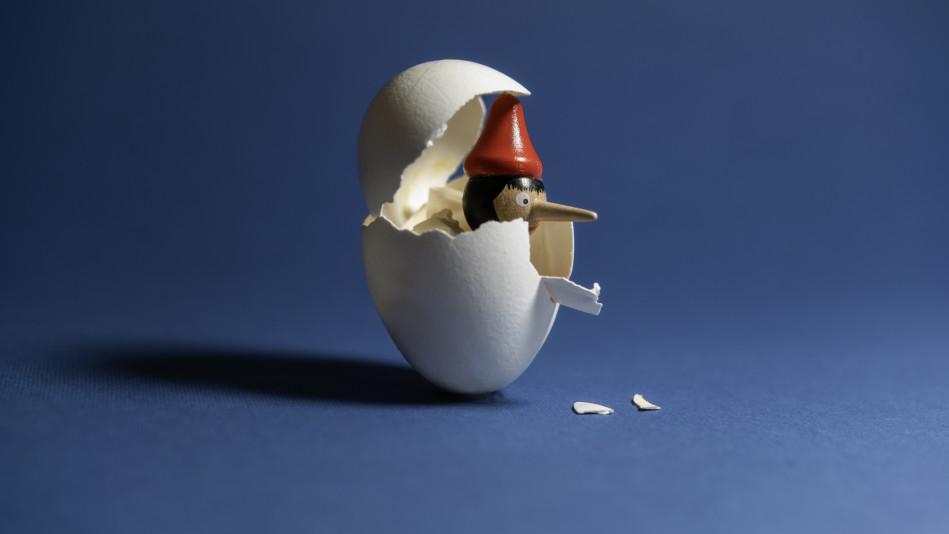 Pinocchio breaking through an eggshell