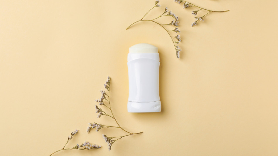 deodorant stick on yellow background