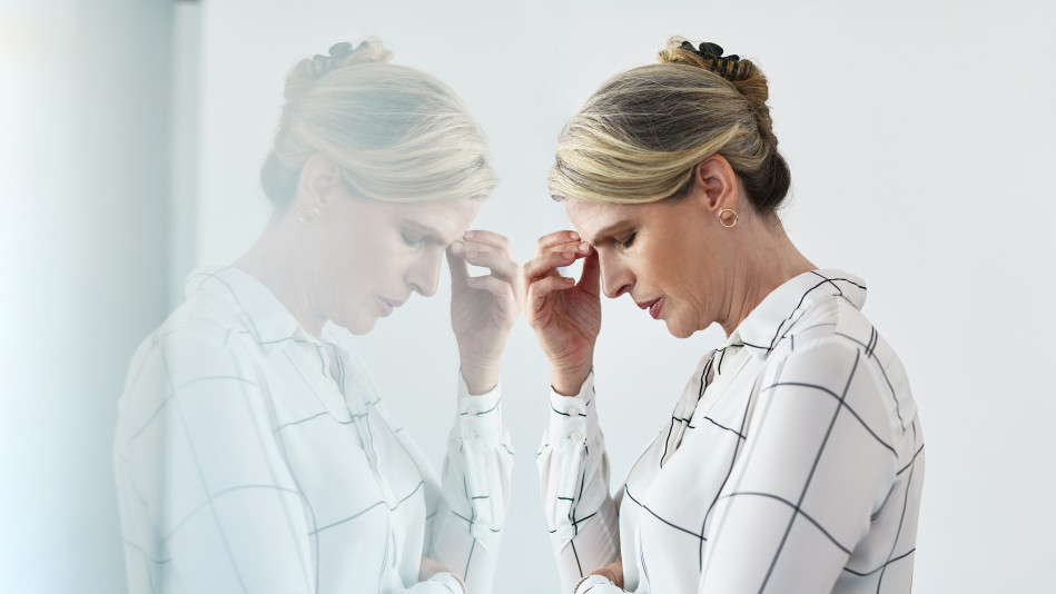 Woman with a headache in her office