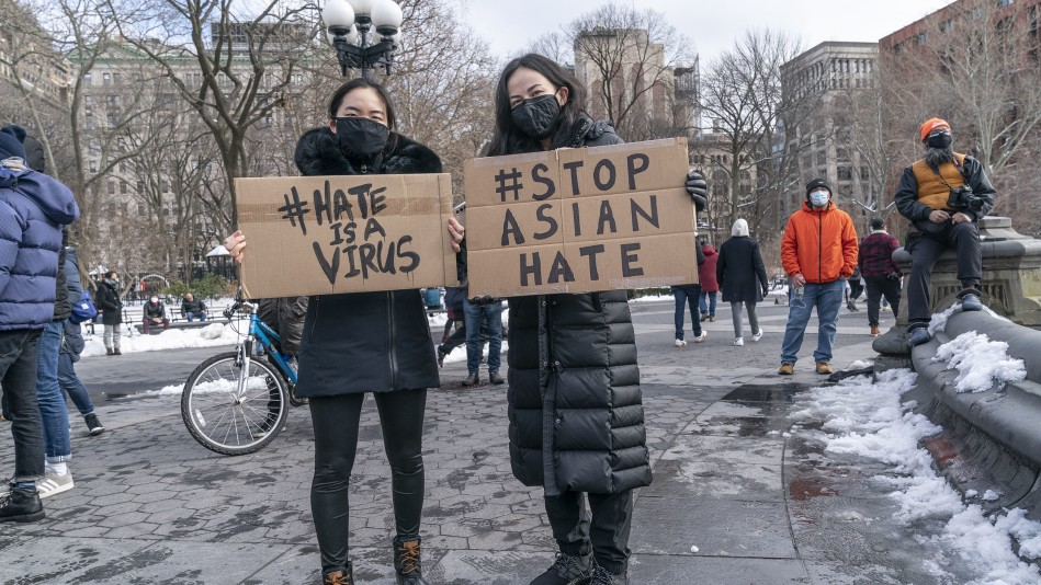 Women protesting hate crimes against Asian people