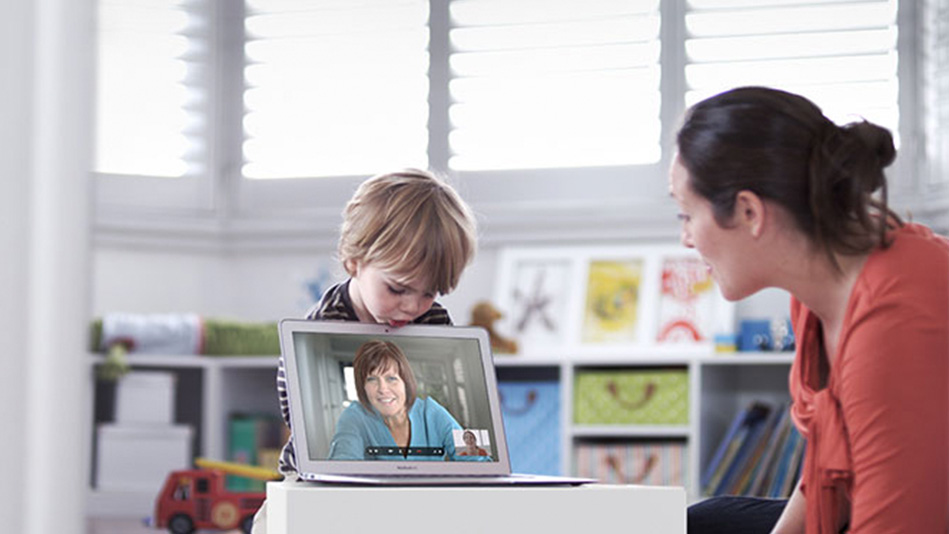mom and son talking to grandma on Skype