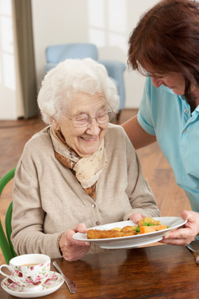 Serving meals to a senior woman