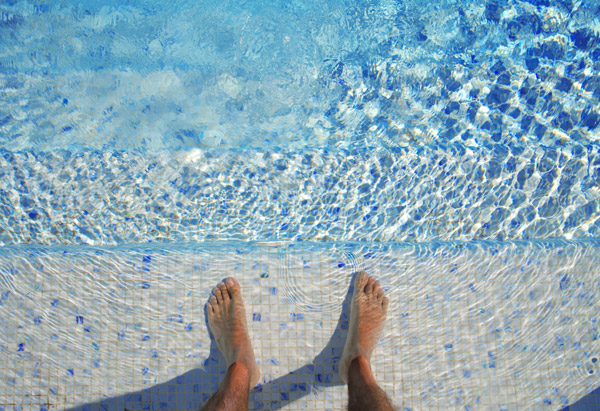 Dipping feet into a pool