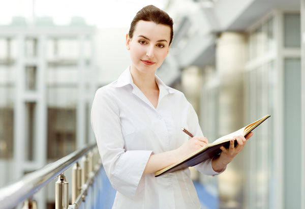 woman taking notes