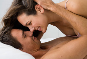 Man and woman embracing in bed