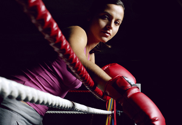Woman standing in boxing ring
