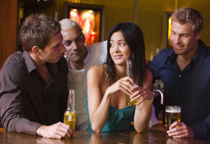girl surrounded by guys in bar