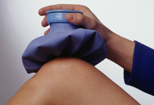 woman holding ice pack on knee
