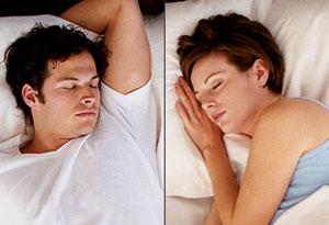 couple sleeping apart