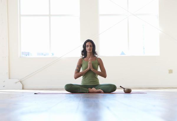 Woman meditates for energy