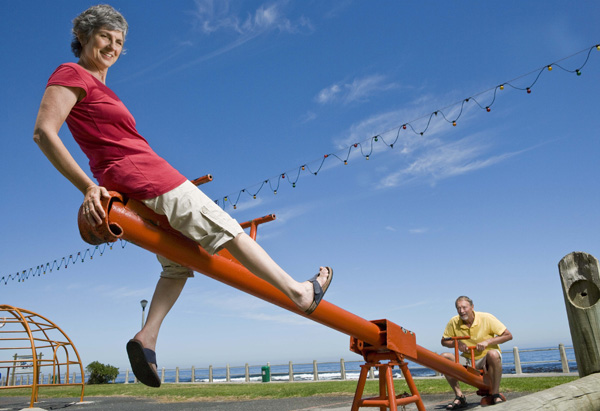 Man and woman on seesaw