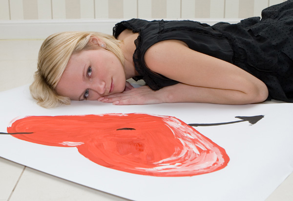 Woman laying on floor with heart