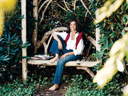 Dianne Wallace sitting in her garden