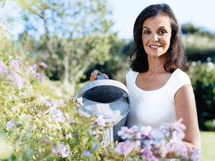 Dianne Wallace with a watering can