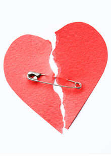 Paper broken heart with safety pin
