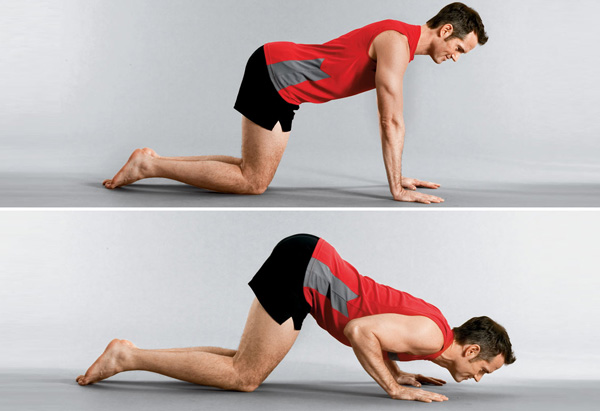 Joel Harper demos the push-up pride exercise.