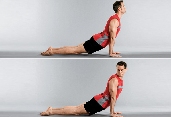 Joel Harper demos the up, dog, up exercise.