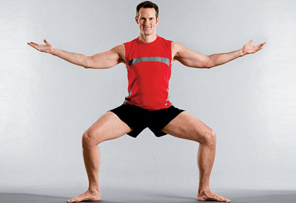 Joel Harper demos the squat exercise.