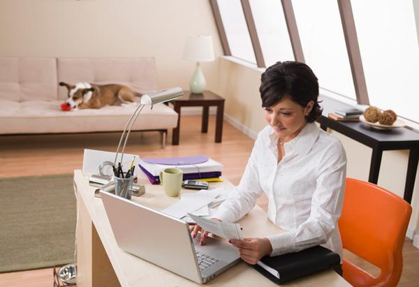 Woman comparison shopping online