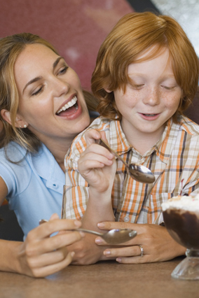 Mother and son eat ice cream