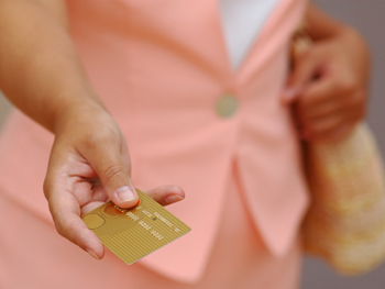 Woman with credit card in hand