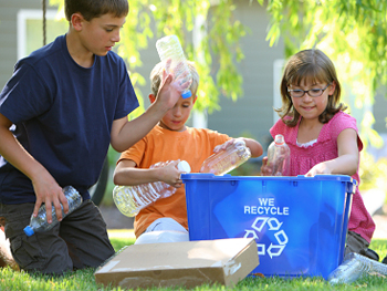 Children helping to recycle
