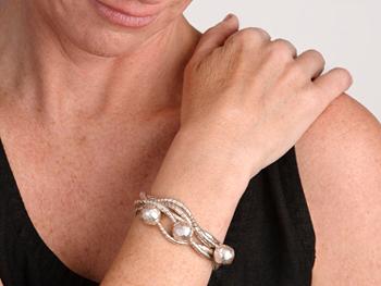Woman's arm touching shoulder
