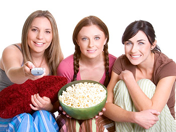 Three teenage girls watching movies