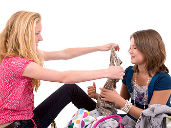 Teenage girls sharing clothes