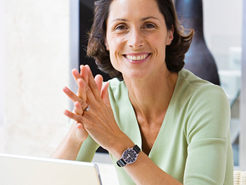 Happy woman sitting at her laptop