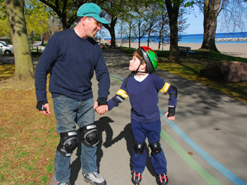 Man and child Rollerblading