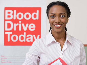 Woman volunteering at blood drive