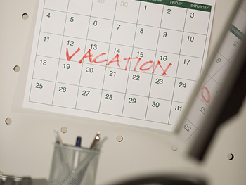 Wall calendar marked with the word vacation