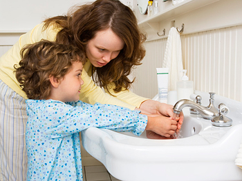 Mother and daughter washing hands