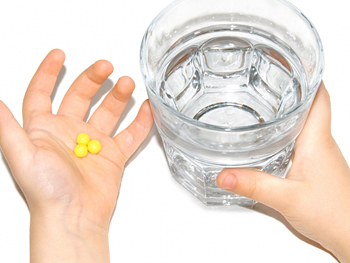 Handful of vitamins and a glass of water