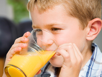 Little boy with glass of juice
