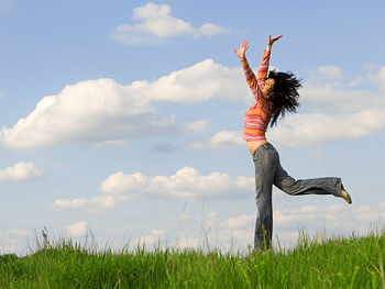 A woman jumping in a field