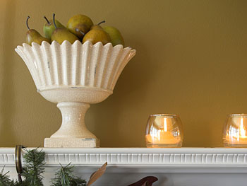 Shelving with a bowl of fruit and candles