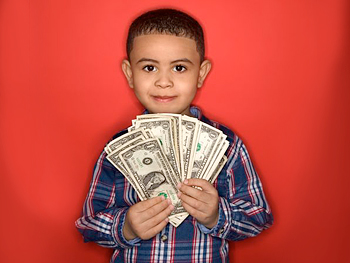 Child holding dollar bills