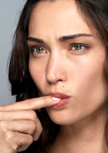 Woman licking her finger