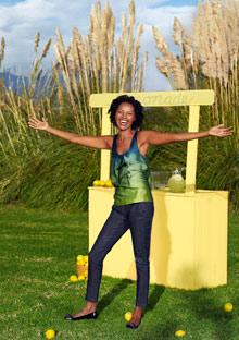 Woman happy at a lemonade stand