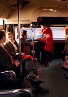 Couple flirting on a bus