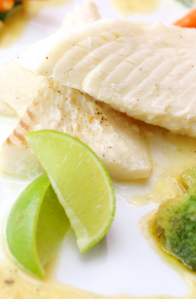Tilapia with lime wedges