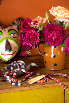 Mask from Oaxaca, African necklace, and French pitcher