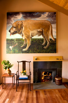 Dog painting, chairs, and fireplace
